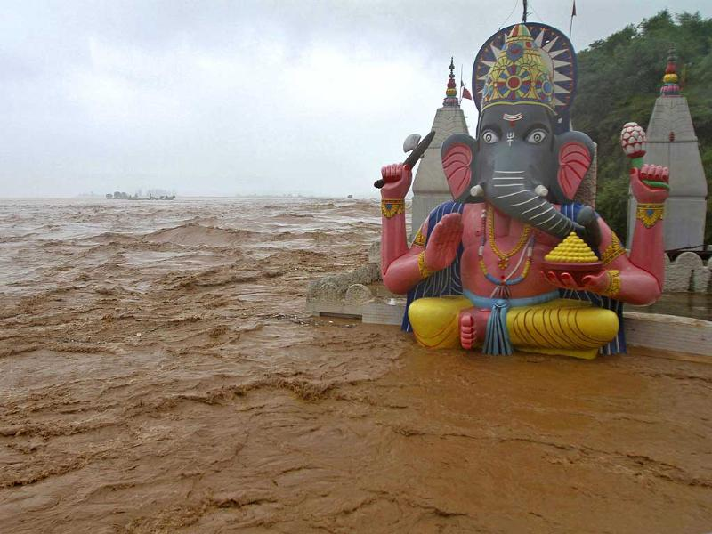 Water from the overflowing river Tawi floods a temple of Lord Ganesh, the deity of prosperity, during heavy rains in Jammu. (Reuters)