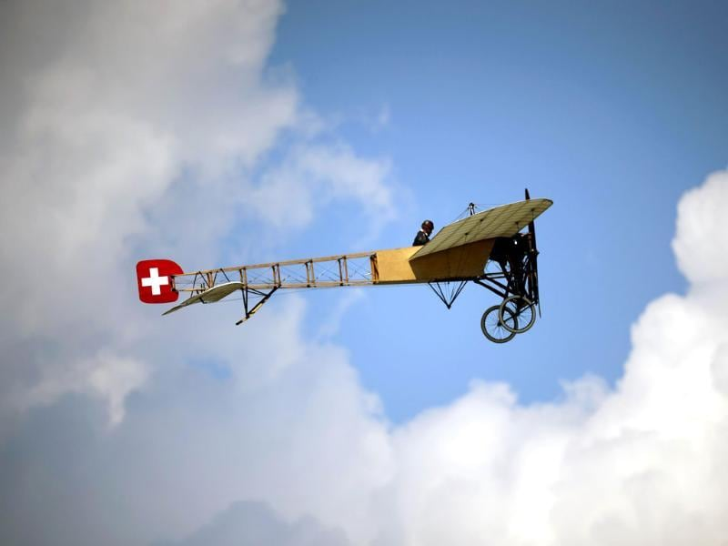 A Bleriot XI-2, the first model used by Swiss Air Force, flies during the second week-end of the AIR14 air show. (AFP photo)