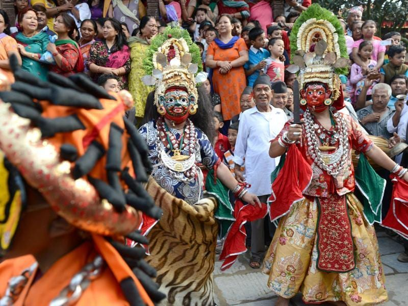 Nepalese traditional masked dancers perform on the first day of the Indra Jatra festival at Hanuman Dhoka in Kathmandu. (AFP photo)