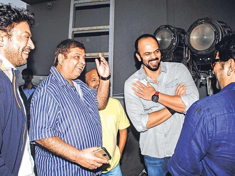 (From left) Irrfan Khan, David Dhawan, Sameer, Rohit Shetty and Arshad Warsi (back facing the camera) were caught sharing a lighter moment at a movie promotion (Photo: Prodip Guha)