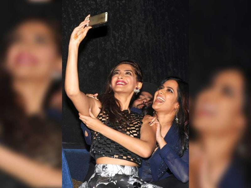 Sonam Kapoor takes a selfie with playback singer Sona Mohapatra during the music launch for Khoobsurat in Mumbai. (AFP Photo)