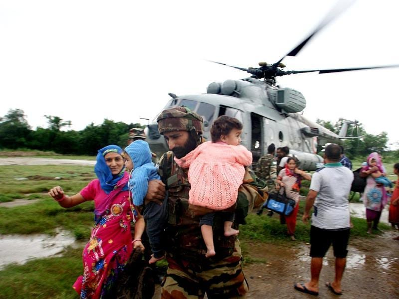 IAF Helicopters carrying out rescue, relief evacuation of people marooned during the flood fury in Jammu and Kashmir. (Photo by IAF)