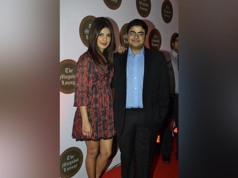 Actor Priyanka Chopra with her brother Siddharth Chopra during the launch of his pub-lounge entitled Mugshot Lounge in Pune on September 7, 2014. (Photo: IANS)