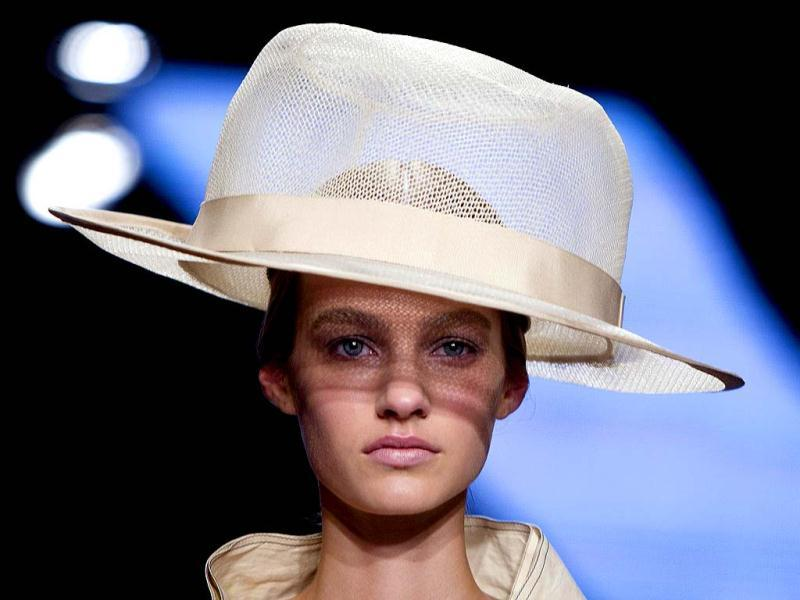 A model presents a creation during the Donna Karan show, where much of the whimsy came in the bold colors, the lively prints, and the truly unusual - OK, downright bizarre, but fun - hats by milliner Stephen Jones. (Reuters)