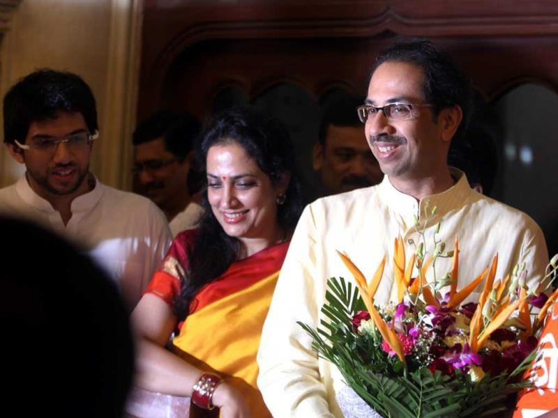 Shiv Sena chief Uddhav Thackeray and his wife congratulate the newly-elected mayor of Mumbai Snehal Ambekar at BMC headquarters in Mumbai. (Kunal Patil/HT photo)