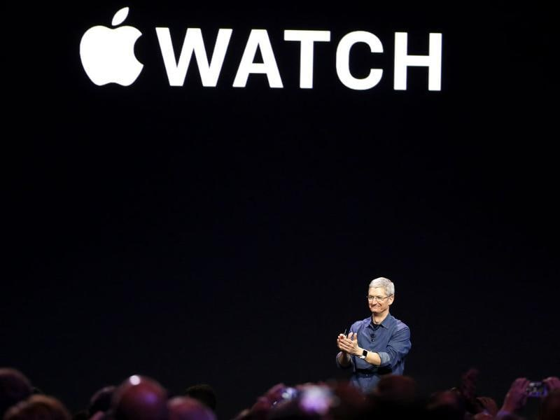 Apple CEO Tim Cook applauds as he unveils the Apple Watch during an Apple event at the Flint Center in Cupertino, California. (Reuters Photo)