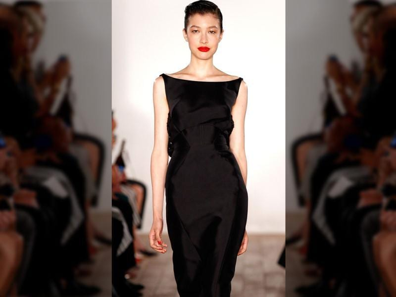 A model walks the runway in a little black dress that skims over her lower half of the body at the Zac Posen fashion show during Mercedes-Benz Fashion Week Spring 2015 in New York City. (AFP)