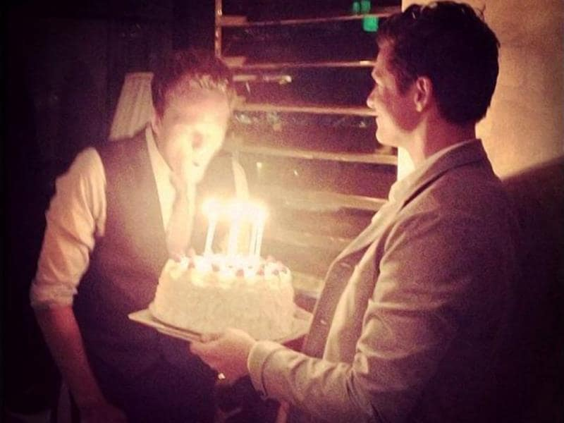 Here is David carrying the birthday cake for Neil last year. Such an adorable picture, isn't it?