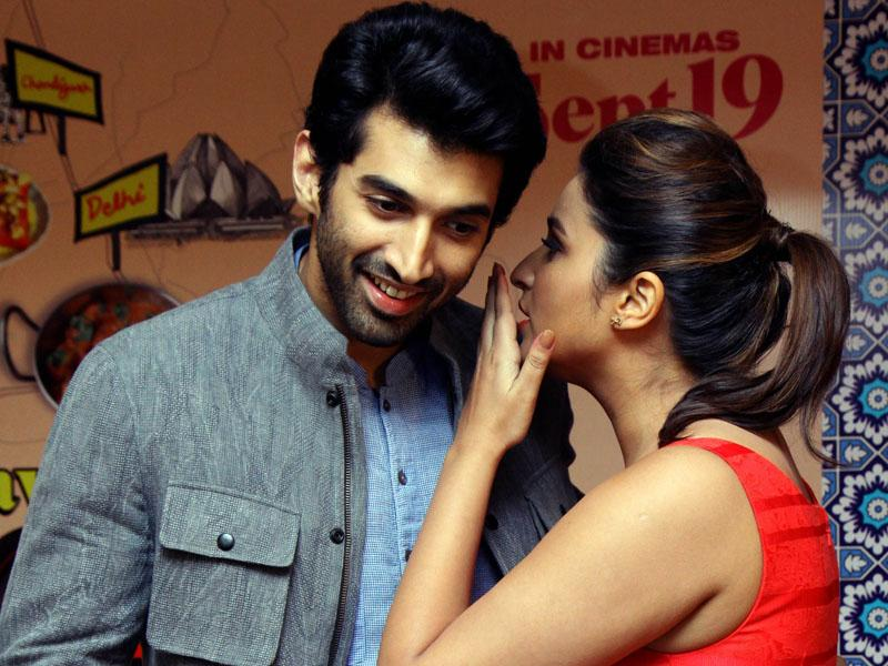 Bollywood actors Aditya Roy Kapur and Parineeti Chopra talk during a promotional event for their forthcoming Hindi film 'Daawat-E-Ishq' directed by Habib Faisal and produced by Aditya Chopra in Mumbai on September 9, 2014. (AFP)
