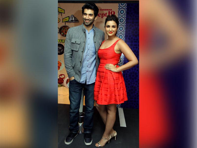 Directed by Habib Faisal, Aditya-Parineeti starrer 'Dawaat -E-Ishq' is a romantic comedy based around food that is all set to release on September 19. Here, the Bollywood actors pose for a photograph during a promotional event in Mumbai on September 9, 2014. (AFP)