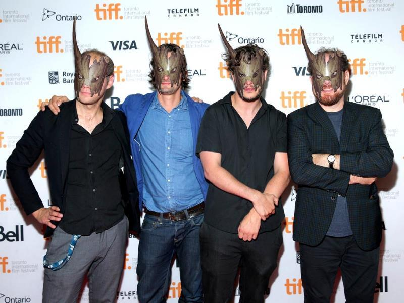 (L-R) Producer Peter De Maegd, executive producer Louis Tisne, screenwriter Jonas Govaerts and TIFF Midnight Madness programmer Colin Geddes attends the Cub premiere during the 2014 Toronto International Film Festival on September 10, 2014 in Toronto, Canada. (AFP)