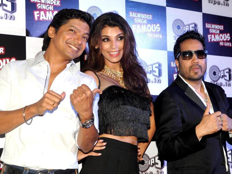 Shaan and Mika Singh share the stage with Brazilian Model and Bollywood actor Gabriela Bertante at a promotional event for the forthcoming Hindi film Balwinder Singh Famous Ho Gaya. (AFP Photo)