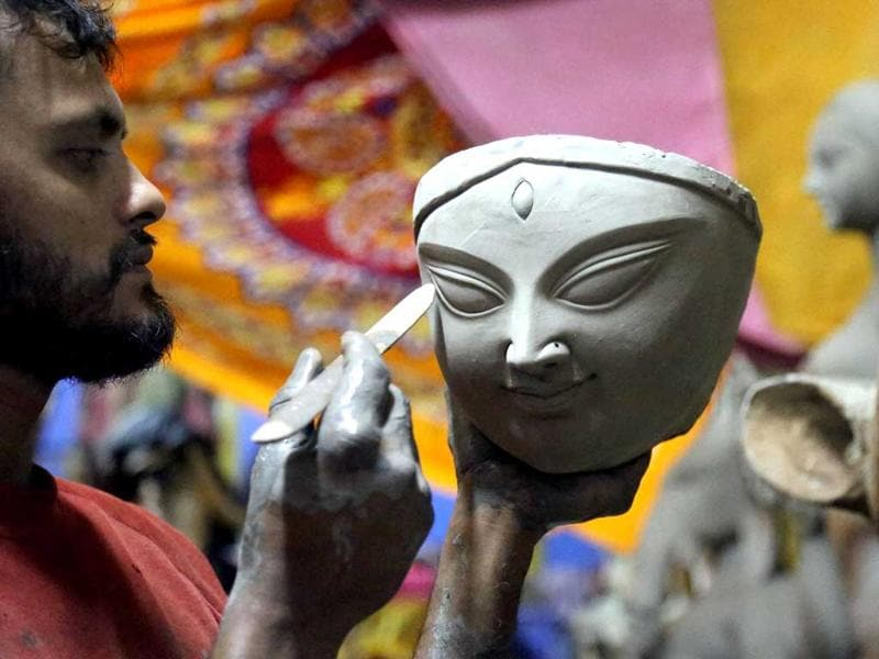 An artist gives gives final touches to an idol of the Goddess Durga ahead of Navratri festival in Mumbai. (PTI photo)