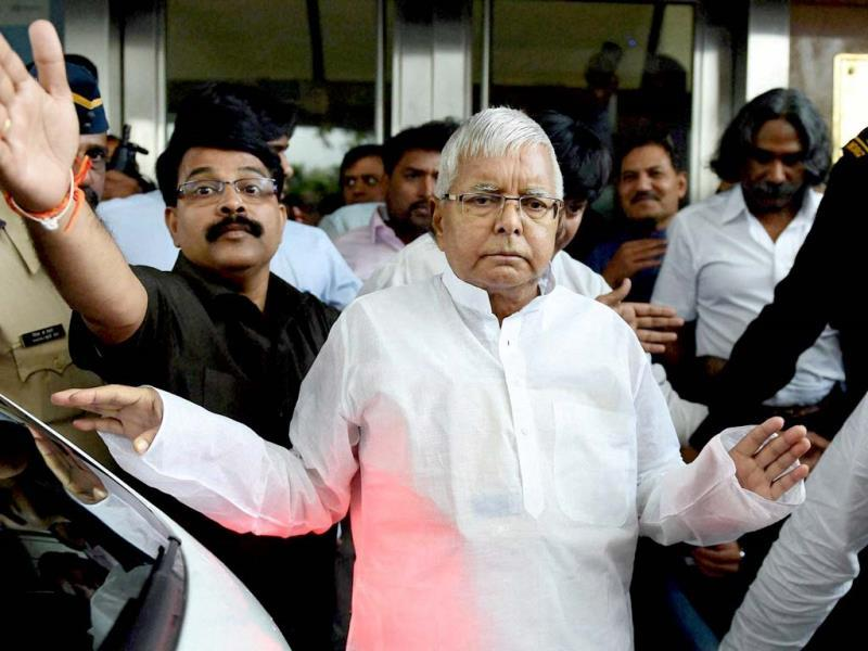 RJD chief Lalu Prasad leaves Asian Heart Hospital after going through a triple cardiac surgery in Mumbai. (PTI photo)