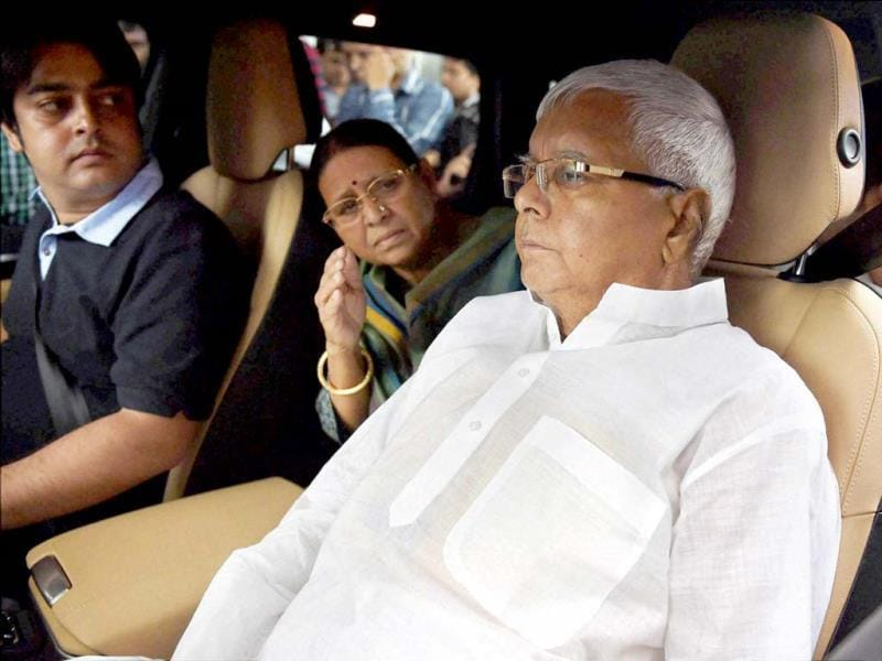 RJD chief Lalu Prasad leaves Asian Heart Hospital with his wife Rabri Devi after going through a triple cardiac surgery in Mumbai. (PTI photo)