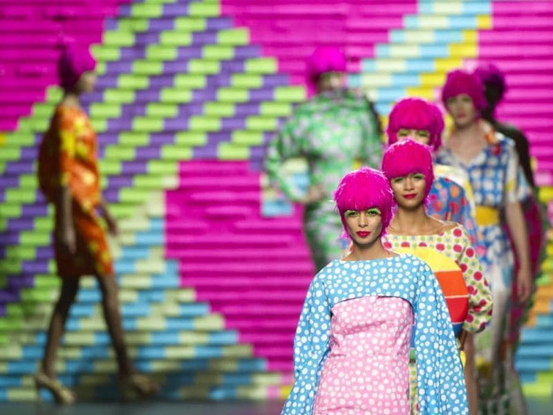 Models present creations by well-known and respected Spanish fashion designer Agatha Ruiz de la Pradaa during the 2015 Spring/Summer Madrid Fashion Week in Madrid. (AFP Photo)