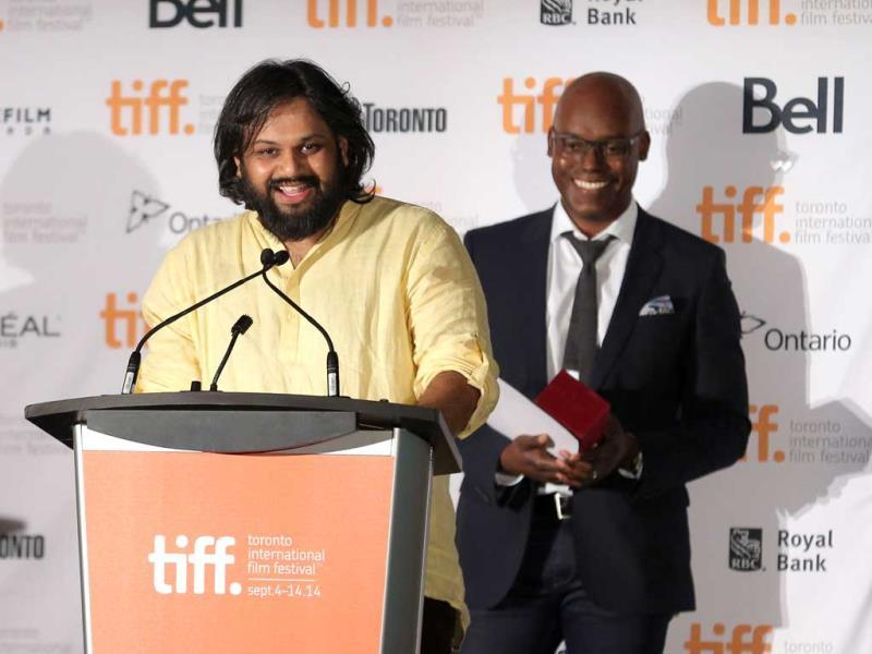 Filmmaker Nilesh Maniyar, winner of the NETPAC Award for Margarita, with a Straw (left) and TIFF Artistic Director Cameron Bailey speak onstage at the TIFF Awards Brunch during the 2014 Toronto International Film Festival on September 14, 2014 in Toronto, Canada. (AFP)