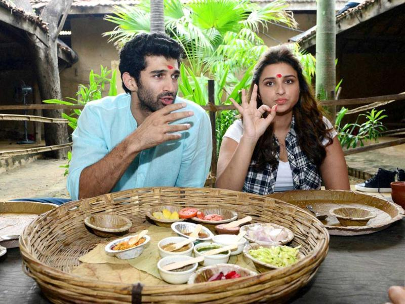 Actors Aditya Roy Kapoor and Parineeti Chopra enjoy a Gujarati lunch in Ahmedabad during their promotional event #FoodYatra for their up coming movie Daawat-e-Ishq. (PTI Photo)