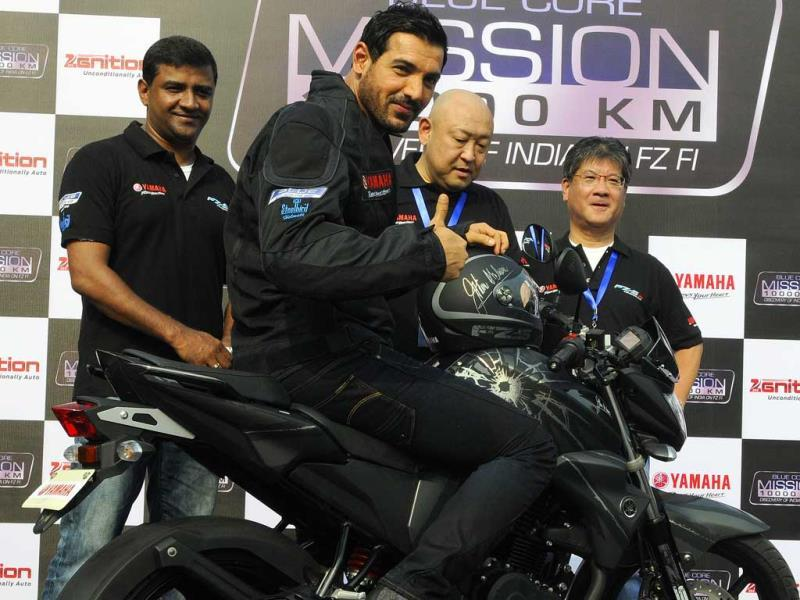 Masaki Asano Managing Director Yamaha motor, with others present a Special edition FZS FI Version bike as John Abraham looks on during the Yamaha's Mission 10000KM' flagged off ceremony in New Delhi. (Photo: Sonu Mehta/HT)