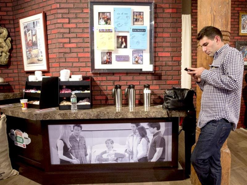 A man checks his phone in the fictitious shop. The shop is the iconic place where our beloved characters Monica, Rachel, Phoebe, Chandler, Ross and Joey spent majority of their time. REUTERS