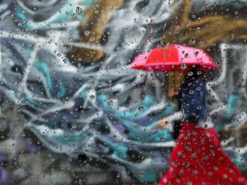 A woman walks past graffiti on a wall in the Williamsburg neighborhood of the borough of Brooklyn, in New York. (Reuters)