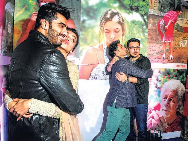 Ranveer Singh finds solace in Dinesh's hugs even as Deepika pretends to kiss Finding Fanny co-star Arjun Kapoor.