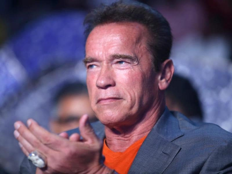 Kindergarten Cop star Arnold Schwarzenegger applauds a performance at the audio launch of I.