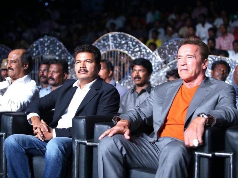 Shankar, flanked by superstars Rajinikanth and Arnold Schwarzenegger watch the audio launch event.