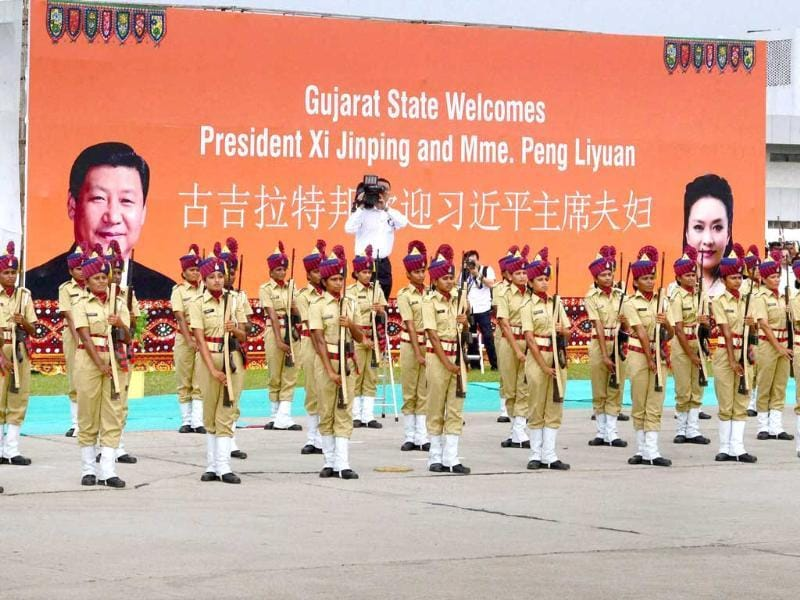 Police personnel presenting a guard of honour tp Chinese President XI Jinping upon his arrival at Sardar Patel International Airport in Ahmedabad. (PTI Photo)