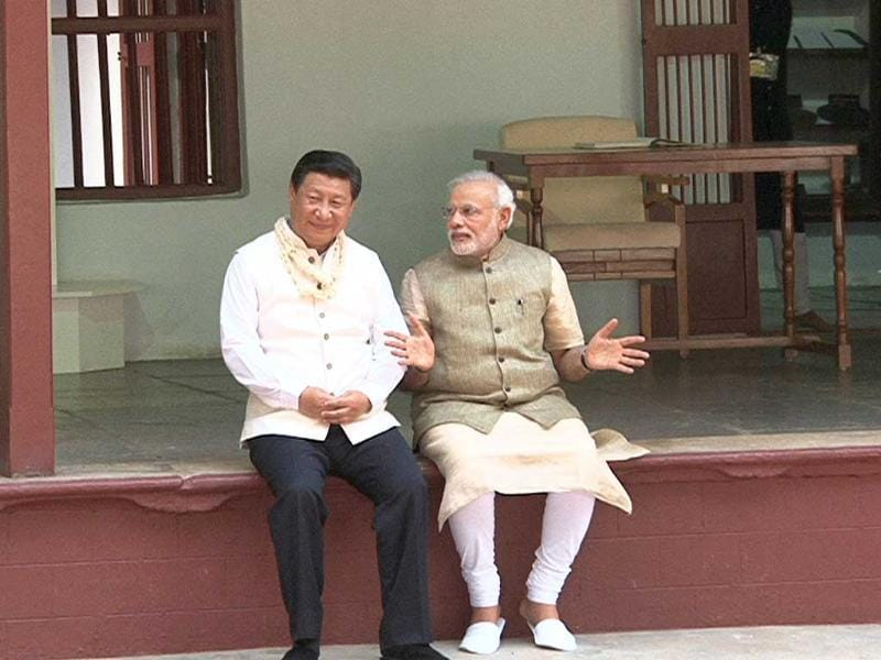China's President Xi Jinping and Indian Prime Minister Narendra Modi share a quiet moment at the Sabarmati Ashram in Ahmedabad. (AFP Photo/Gujarat Information Bureau)
