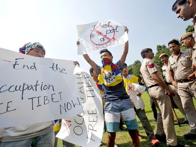 Tibetan exiles shout slogans while holding placards and banners in protest against the Chinese President's visit to New Delhi near the Chinese embassy on Wednesday. PM Modi is determined to build closer relations with China, whose leader comes with pledges to invest billions of dollars in railways, industrial parks and roads. (Reuters)