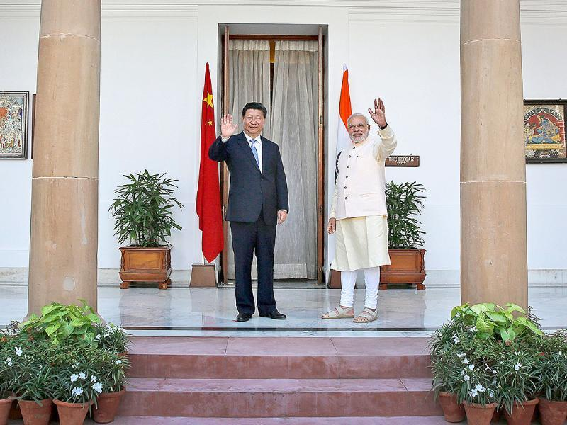 PM Modi and Xi Jinping before a meeting in New Delhi on Thursday. Xi and Modi will hold talks aimed at boosting trade and Chinese investment even as their troops face-off along their disputed border in the Himalayas. (AP Photo)