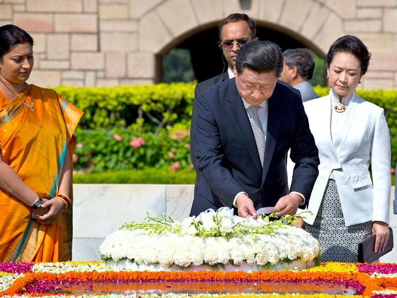 Chinese President Xi Jinping and wife Peng Liyuan offer a floral tribute at Rajghat in New Delhi last year. (AP File Photo)