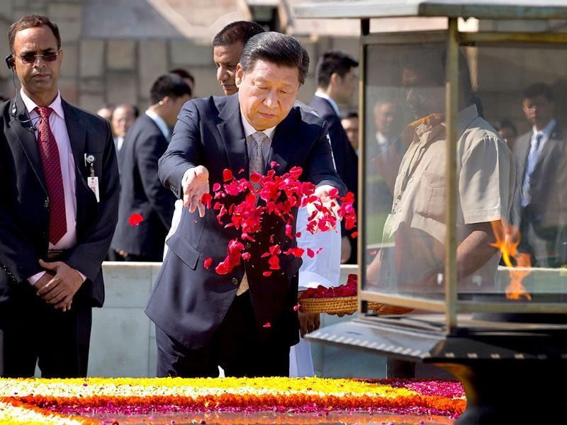 Chinese President Xi Jinping offers a floral tribute at Rajghat, the memorial to Mahatma Gandhi in New Delhi on Thursday. (AP Photo)