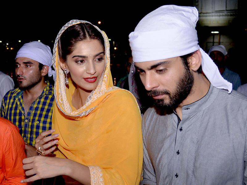 Sonam Kapoor and Fawad Khan pay their respects at the Golden temple in Amritsar. (AFP)
