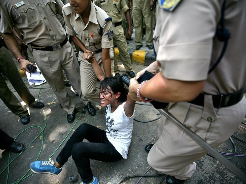 A Tibetan activist is detained by the police during a protest outside Hyderabad House in New Delhi on Thursday. (Arun Sharma/HT Photo)