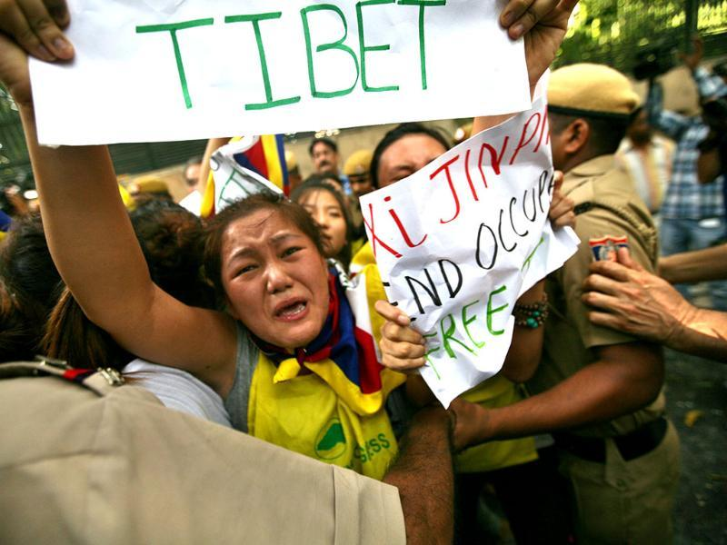 A Tibetan activist is detained by Indian police during the protest outside Hyderabad House in New Delhi on Thursday. (Arun Sharma/HT Photo)