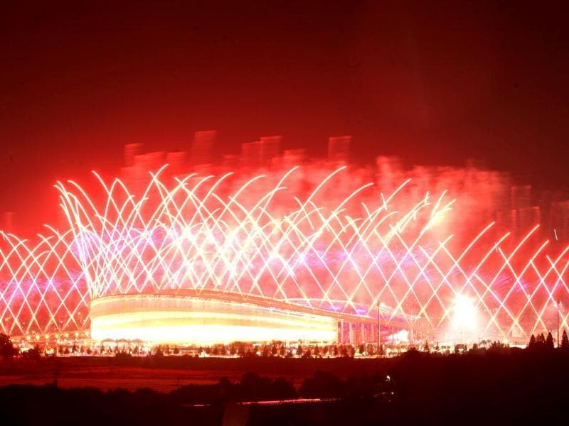Fireworks explode over Incheon Asiad Main Stadium during the opening ceremony for the 17th Asian Games in Incheon, South Korea. (AP Photo/Yonhap, Sung Yeon-je)