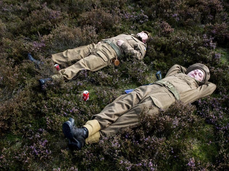 Visitors in WWII uniforms lie on their backs on the Ginkelse Heide, Ede, The Netherlands. (AFP photo)