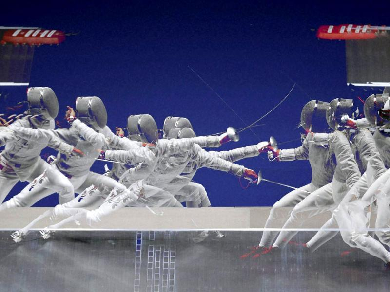 In this multi-exposure photo, South Korea's Kim Ji-yeon, left, and China's Shen Chen, right, compete during the women's sabre individual semifinal fencing competition at the 17th Asian Games in Incheon, South Korea. (AP/PTI)