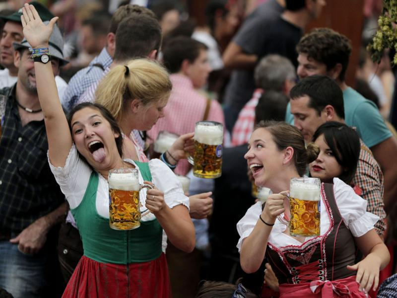 Young women celebrate the opening of the 181th Oktoberfest beer festival in Munich. (AP photo)