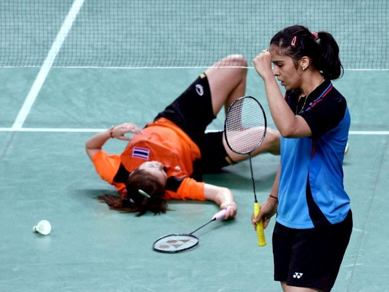 India's Saina Nehwal celebrates after a scoring a point against Thailand's R Invtanon during their Badminton singles quaterfinal match at Asian Games 2014 in Inchoen, South Korea . (PTI photo)