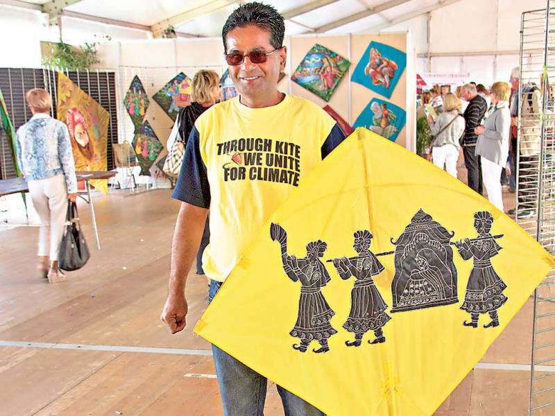 Ashghar Belim of Jodhpur holds up a kite with his wife's embroidery work. (Photo: Noopur Tiwari)