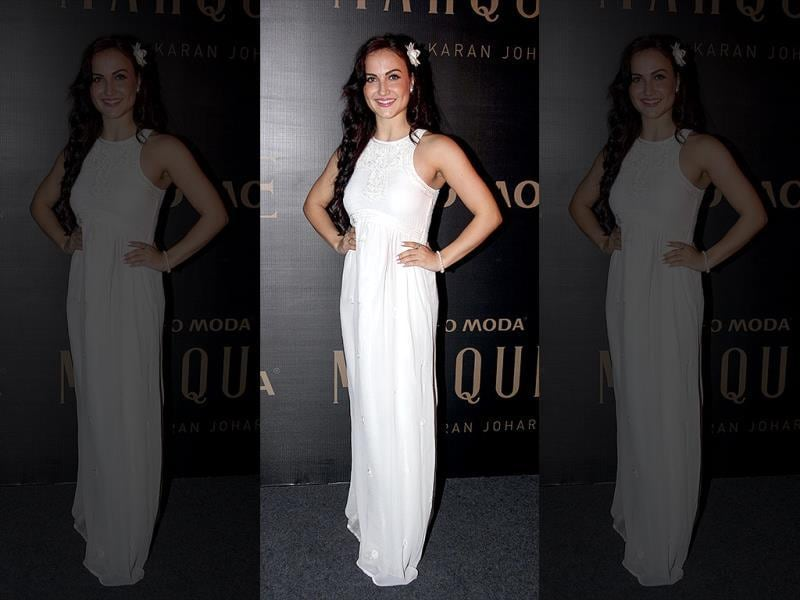 Elli Avram looks pretty as a daisy in this white floor-length gown.