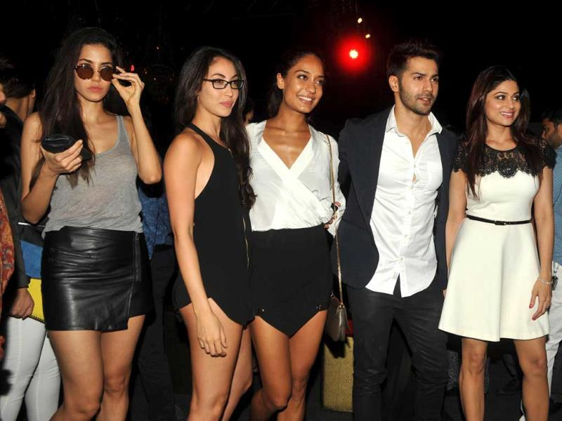 Lisa Haydon (centre) looks chic in a deep-plunge white top and black asymetrical skirt.