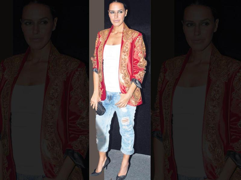 The ugly: Neha Dhupia at a fashion event OURTAKE: Trying to pull off tattered boyfriend jeans and that jacket at the same time backfired for Neha. There's too much going on, and even the safe black accessories don't help tone down the look.