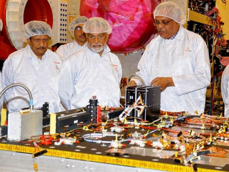 ISRO's Chairman visiting the MOM clean room, before the mission was launched. Image from ISRO brochure.