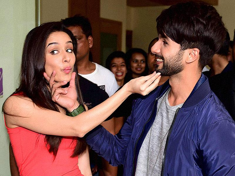 Being cute, are we? Shahid Kapoor and Shraddha Kapoor snapped in some candid moments at a promotional event for their film Haider. Browse through. (PTI Photo)