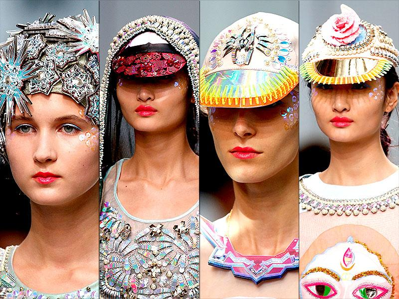 At the Palais de Tokyo in Paris, Manish Arora unveiled his Spring-Summer 2015 collection. In terms of accessories, there was an array of bejeweled headwear. His beads, rhinestones and sequins adorned caps were as shimmery as the rest of the line. While the collection featured an array of pastels, one color was particularly conspicuous: pink. Check out all the trends spotted at the show. (All Photos: AFP)