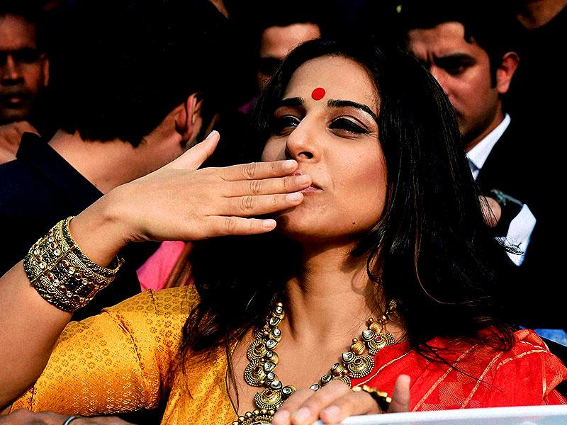 Bollywood actress Vidya Balan gestures towards fans during a promotional event in Kolkata. (PTI Photo by Swapan Mahapatra)